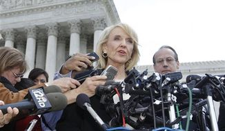 """** FILE ** In this Wednesday, April 25, 2012, file photo, Arizona Gov. Jan Brewer speaks to reporters after the Supreme Court questioned Arizona's """"show me your papers"""" immigration law in front of the Supreme Court in Washington. (AP Photo/Charles Dharapak)"""