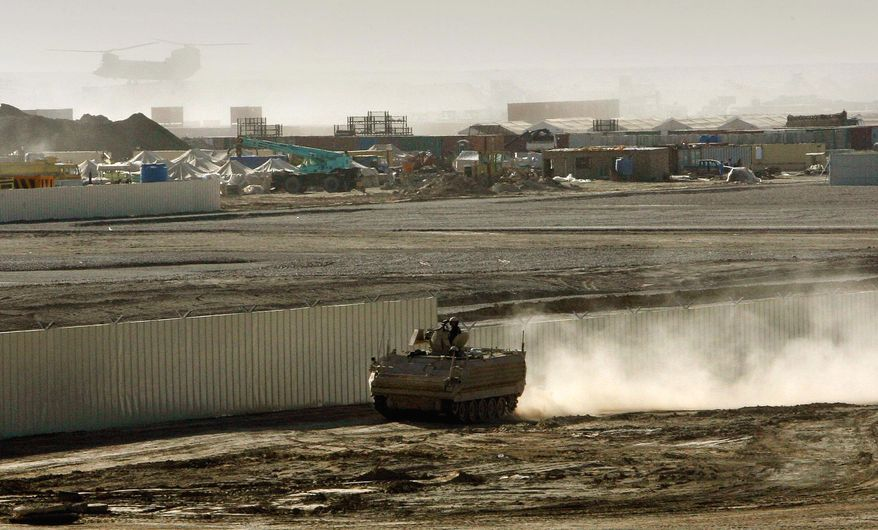 **FILE** An armored vehicle patrols on the periphery of Camp Bastion in southern Afghanistan on Jan. 10, 2007. (Associated Press)