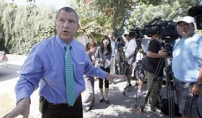 """Los Angeles Sheriff's Department spokesman Steve Whitmore speaks to media outside the home of Nakoula Basseley Nakoula on Thursday, Sept. 13, 2012, in Cerritos, Calif. Nakoula, has said that he helped with logistics for the filming of """"Innocence of Muslims,"""" which mocked Muslims and the prophet Muhammad and may have inflamed mobs that attacked U.S. missions in Egypt and Libya. (AP Photo/Nick Ut)"""