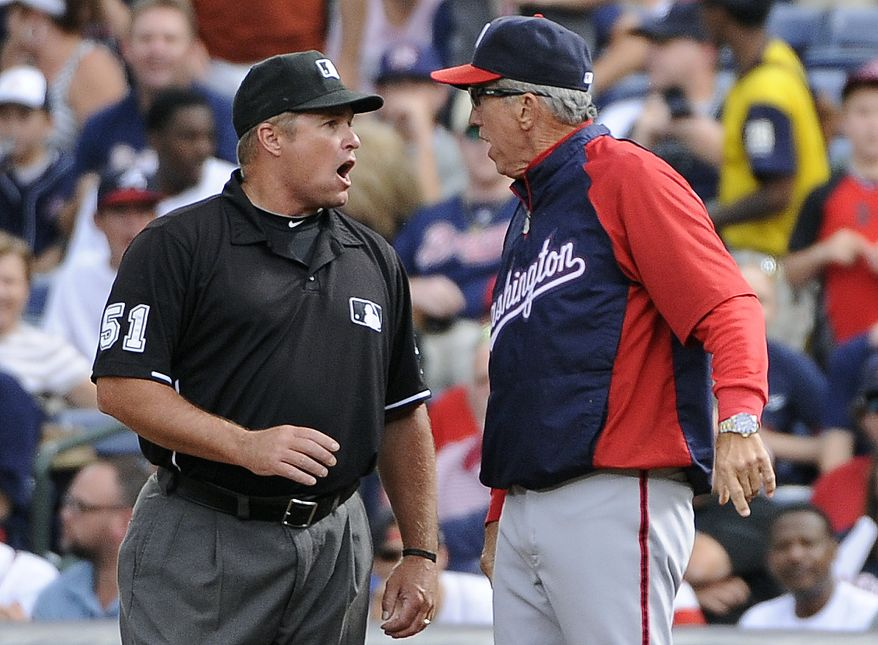 Nationals manager Davey Johnson was ejected for the first time this season on Saturday, arguing with umpire Marvin Hudson about a blown call at first base. (Associated Press)