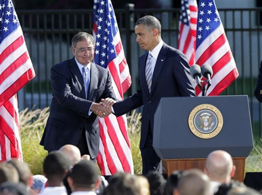 Defense Secretary Leon Panetta shakes hands with President Barack Obama after the president spoke at a ceremony marking the 11th anniversary of the terrorist attacks at the Pentagon, Tuesday, Sept. 11, 2012. (AP Photo/J. Scott Applewhite)