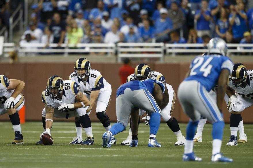 St. Louis Rams quarterback Sam Bradford (8) gets set under center Robert Turner (59) during an NFL game against the Detroit Lions in Detroit, Sunday, Sept, 9, 2012. (AP Photo/Rick Osentoski)