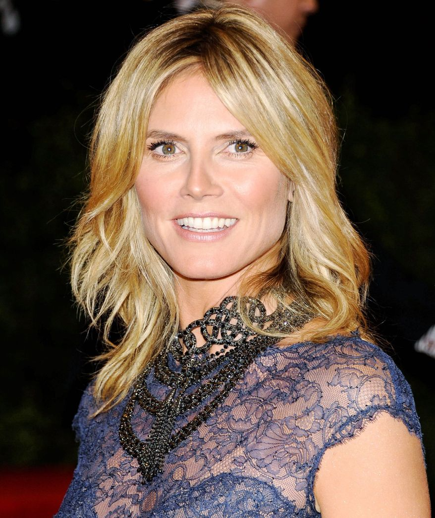 Heidi Klum denied that she cheated on her husband, pop singer Seal. (Associated Press)