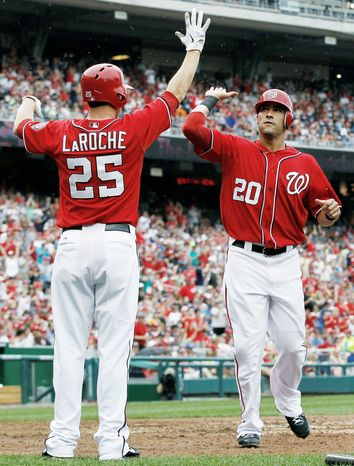 The Nationals, with big boosts from Adam LaRoche and Ian Desmond, have not discussed, formally at least, how they might celebrate when they assure themselves of a playoff spot. (Associated Press)