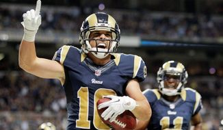 associated press  St. Louis wide receiver Danny Amendola celebrates his 1-yard touchdown catch in the second quarter Sunday. He finished with 15 grabs for 160 yards.