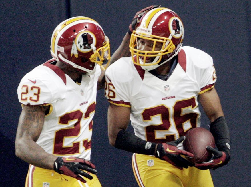 ASSOCIATED PRESS  Redskins cornerback Josh Wilson (right) is congratulated by DeAngelo Hall after returning a fumble for a touchdown during the first quarter.