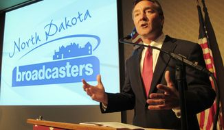Rick Berg, the Republican Senate candidate in North Dakota, speaks in Bismarck, N.D., during a debate with Democratic candidate Heidi Heitkamp. Ms. Heitkamp and Mr. Berg are running for the seat being left open by the departure of incumbent Democrat Kent Conrad, and Mr. Berg is seen as crucial to GOP hopes of capturing control of the Senate. (Associated Press)
