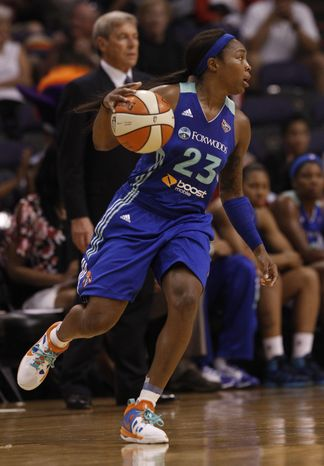 New York Liberty's Cappie Pondexter dribbles against the Phoenix Mercury's during a WNBA basketball game Thursday, Aug. 23, 2012, in Phoenix.  The Liberty defeated the Mercury 89-77. (AP Photo/Ross D. Franklin)
