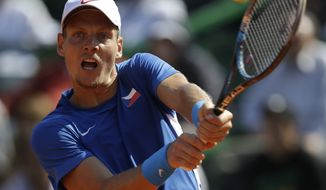 Czech Republic's Tomas Berdych returns the ball to Argentina's Carlos Berlocq during the Davis Cup semifinals tennis match in Buenos Aires, Argentina on Sunday, Sept. 16, 2012. (AP Photo/Eduardo Di Baia)