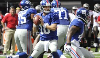 ** FILE ** New York Giants quarterback Eli Manning (10) looks to pass as teammates Sean Locklear (75) and Kevin Boothe (77) block during the first half of an NFL football game against the Tampa Bay Buccaneers Sunday, Sept. 16, 2012, in East Rutherford, N.J. (AP Photo/Bill Kostroun)