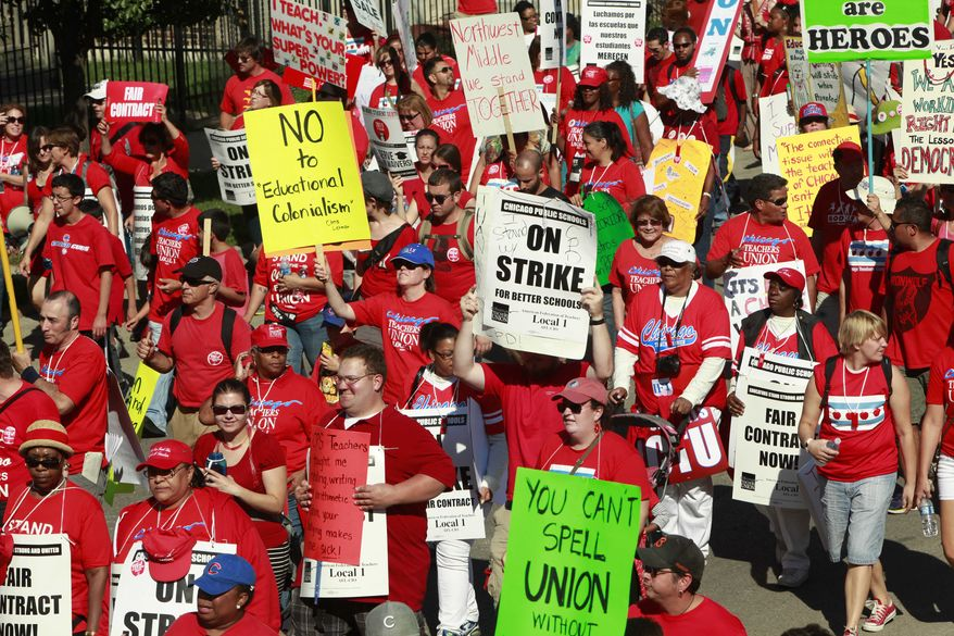 Striking schoolteachers march after a rally on Saturday, Sept. 15, 2012, in Chicago. (AP Photo/Sitthixay Ditthavong)
