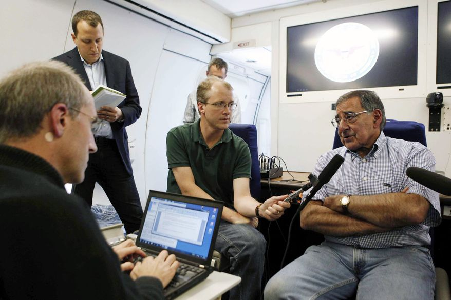 Secretary of Defense Leon E. Panetta (right) speaks to reporters aboard his aircraft on Saturday, Sept. 15, 2012, on the way to official visits to Japan, China and New Zealand. (AP Photo/Larry Downing, Pool)