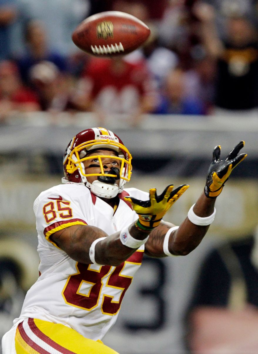 Washington Redskins wide receiver Leonard Hankerson catches a 68-yard pass for a touchdown during the second quarter. (AP Photo/Seth Perlman)