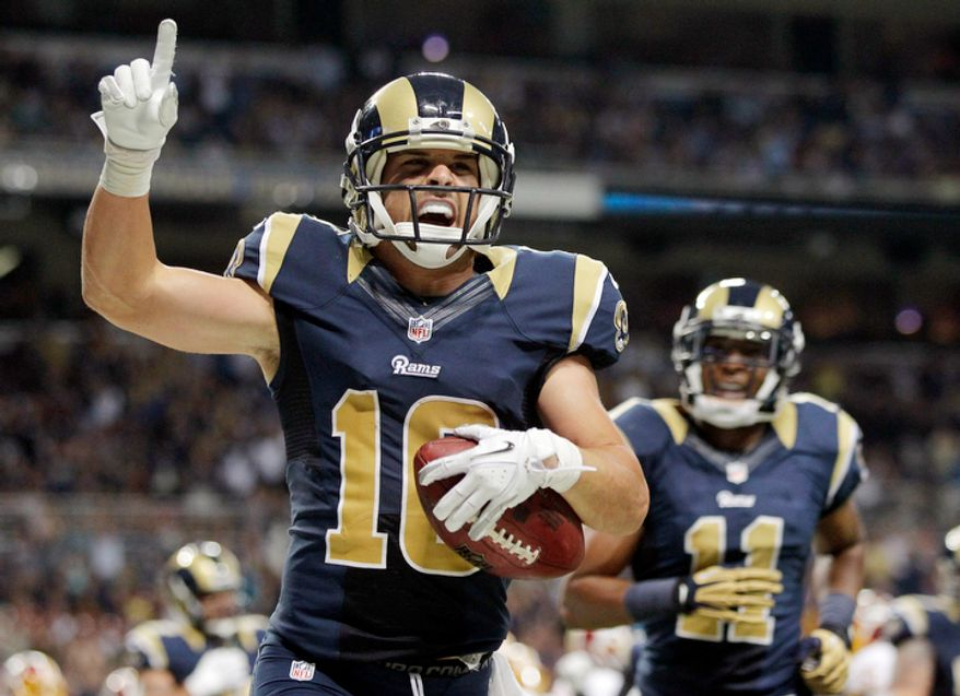 St. Louis Rams wide receiver Danny Amendola, left, celebrates after catching a 1-yard touchdown pass as teammate Brandon Gibson looks on during the second quarter. (AP Photo/Seth Perlman)