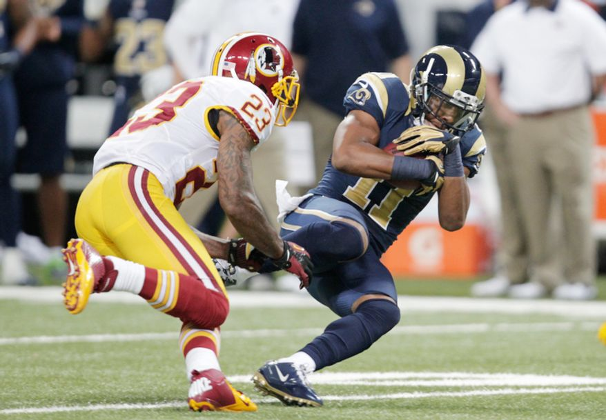 St. Louis Rams wide receiver Brandon Gibson, right, catches a pass as Washington Redskins cornerback DeAngelo Hall defends during the second quarter. (AP Photo/Tom Gannam)
