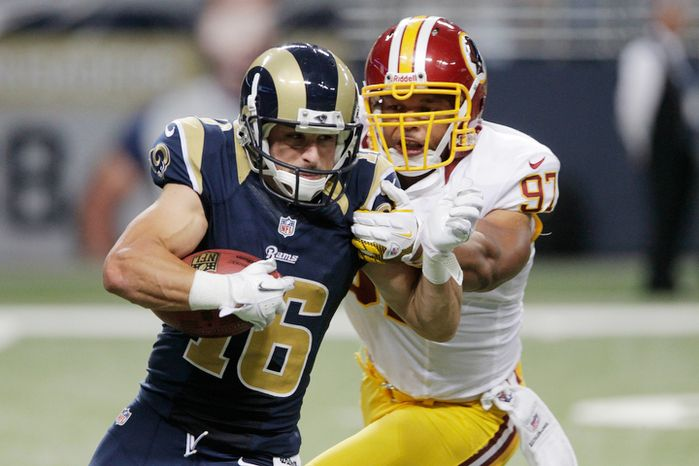 St. Louis Rams wide receiver Danny Amendola, left, runs with the ball as Washington Redskins linebacker Lorenzo Alexander defends during the fourth quarter. (AP Photo/Seth Perlman)