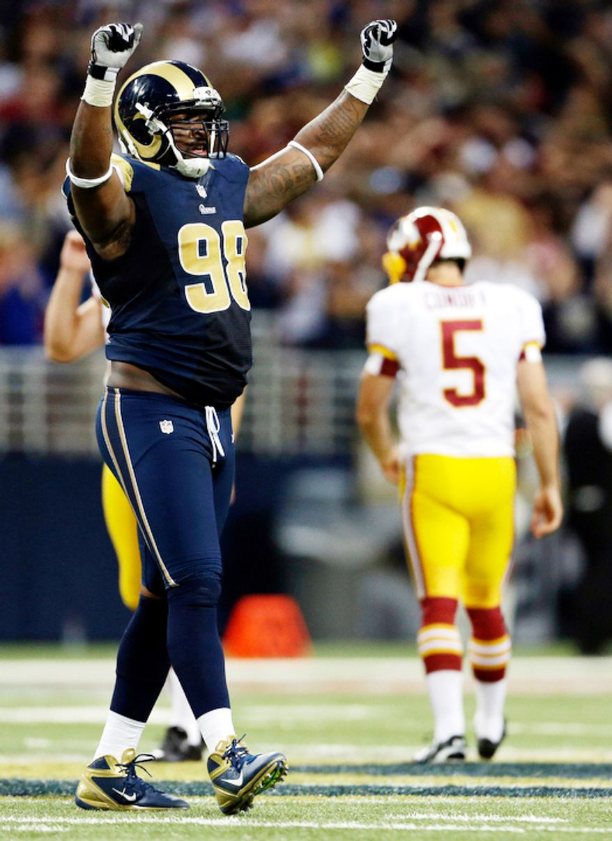 St. Louis Rams' Kendall Langford, left, celebrates after Washington Redskins kicker Billy Cundiff, right, missed a 62-yard field goal-attempt during the fourth quarter. (AP Photo/Jeff Roberson)