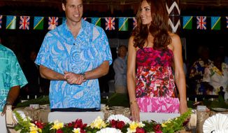 Britain's Prince William and his wife, Kate, prepare to sit for a meal at Government House in Honiara, Solomon Islands, on Sunday, Sept. 16, 2012. The royal couple is on a nine-day tour of the Far East and South Pacific in celebration of Queen Elizabeth II's diamond jubilee. (AP Photo/William West, Pool)