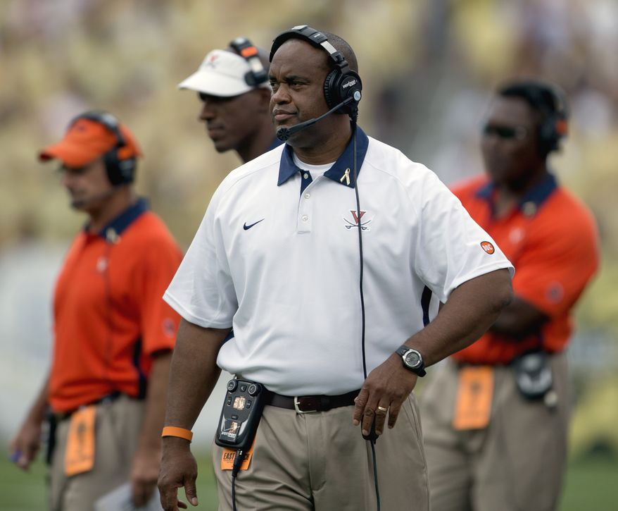 Virginia head coach Mike London, looks on during an NCAA college football game against Georgia Tech Saturday, Sept. 15, 2012, in Atlanta. Georgia Tech won 56-20.(AP Photo/David Goldman)
