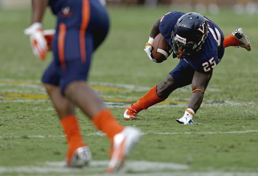 Virginia's Kevin Parks puts his hand down for balance as he runs the ball in an NCAA college football game against Georgia Tech Saturday, Sept. 15, 2012, in Atlanta. Georgia Tech won 56-20. (AP Photo/David Goldman)