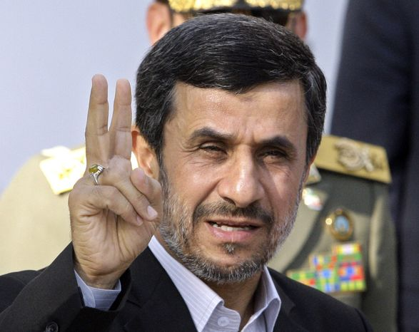FILE - In this Sept. 1, 2012, file photo, Iranian President Mahmoud Ahmadinejad flashes a victory sign in Tehran, Iran. (AP Photo/Vahid Salemi, File)