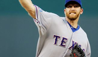 Texas Rangers starting pitcher Ryan Dempster throws during the first inning of a baseball game against the Kansas City Royals, Wednesday, Sept. 5, 2012, in Kansas City, Mo. (AP Photo/Charlie Riedel)