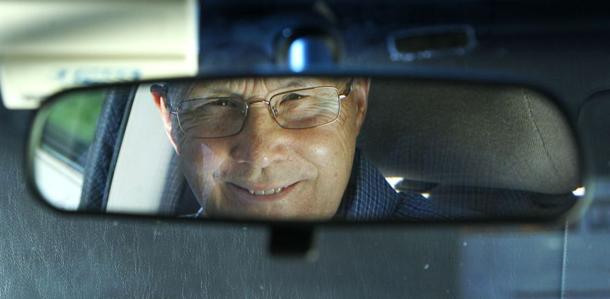 Jerry Wiseman is reflected in the rearview mirror of his vehicle in Schaumburg, Ill., on Sept. 12, 2012. Wiseman and his wife, Sandy, took refresher driving classes to help them stay safe behind the wheel for many more years. (Associated Press)