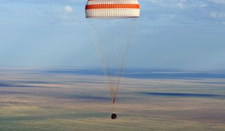 The Soyuz TMA-04M spacecraft lands with Expedition 32 Commander Gennady Padalka of Russia, NASA Flight Engineer Joe Acaba and Russian Flight Engineer Sergie Revin in a remote area near Arkalyk, Kazakhstan, on Monday, Sept. 17, 2012. (AP Photo/NASA, Carla Cioffi)