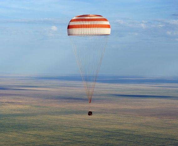 The Soyuz TMA-04M spacecraft lands with Expedition 32 Commander Gennady Padalka of Russia, NASA Flight Engineer Joe Acaba and Russian Flight Engineer Sergie Revin in a remote area near Arkalyk, Kazakhstan, on Monday, Sept. 17, 2012. (AP Photo/NASA, Carla Cioffi)