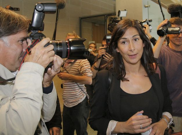Delphine Pando, lawyer for Closer magazine, leaves a court Sept, 17, 2012, in Nanterre, France, where lawyers for the British royal family sought an injunction against the Mondadori publishing house, owned by former Premier Silvio Berlusconi, which published a 26-page spread of topless photos of Prince William's wife Kate. (Associated Press)