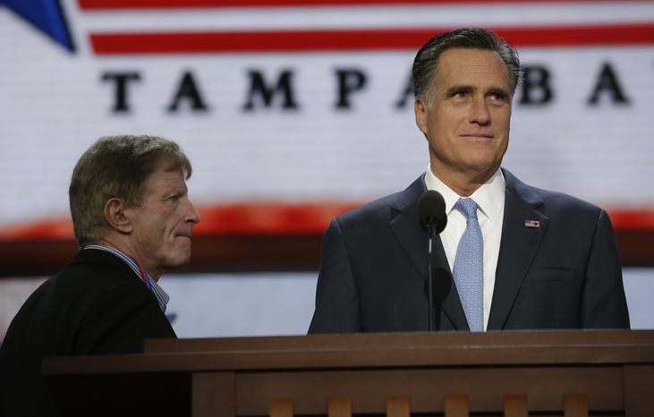 **FILE** Republican presidential candidate Mitt Romney talks with campaign strategist Stuart Stevens during a podium check at the Republican National Convention in Tampa, Fla., on Aug. 30, 2012. (Associated Press)