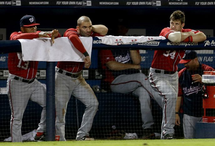 Danny Espinosa, center, will get an MRI on his aching left shoulder on Monday. (Associated Press)