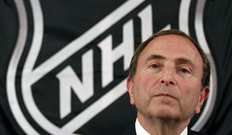 FILE - In this Sept. 13, 2012, file photo, NHL hockey commissioner Gary Bettman listens as he meets with reporters after a meeting with team owners, in New York. The NHL locked out its players at midnight Saturday, becoming the third major sports league to impose a work stoppage in the last 18 months. The action also marks the fourth shutdown for the NHL since 1992, including a year-long dispute that forced the cancellation of the entire 2004-05 season when the league held out for a salary cap. The deal which ended that dispute expired at midnight, and Commissioner Gary Bettman followed through on his longstanding pledge to lock out the players with no new agreement in place.  (AP Photo/Mary Altaffer, File)