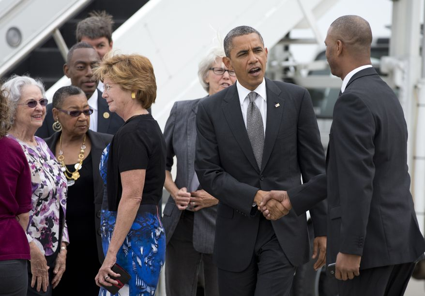 President Obama shakes hands Sept. 17, 2012, with supporters as he arrives on Air Force One at Cincinnati Northern Kentucky International Airport in Hebron, Ky. (Associated Press)