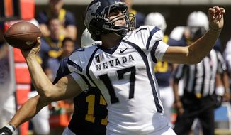 FILE - In this Sept. 1, 2012, file photo, Nevada quarterback Cody Fajardo (17) drops back to pass against California during the first half of an NCAA college football game in Berkeley, Calif. The season is now three weeks old, and the stats are proving what defensive coordinators have known for years_ a dual threat quarterback is still the most dangerous weapon an offense can have. Fajardo, Michigan's Denard Robinson and Ohio State's Braxton Miller are the only quarterbacks in the nation with at least 1,000 yards passing and 300 yards rushing this season. (AP Photo/Ben Margot, File)