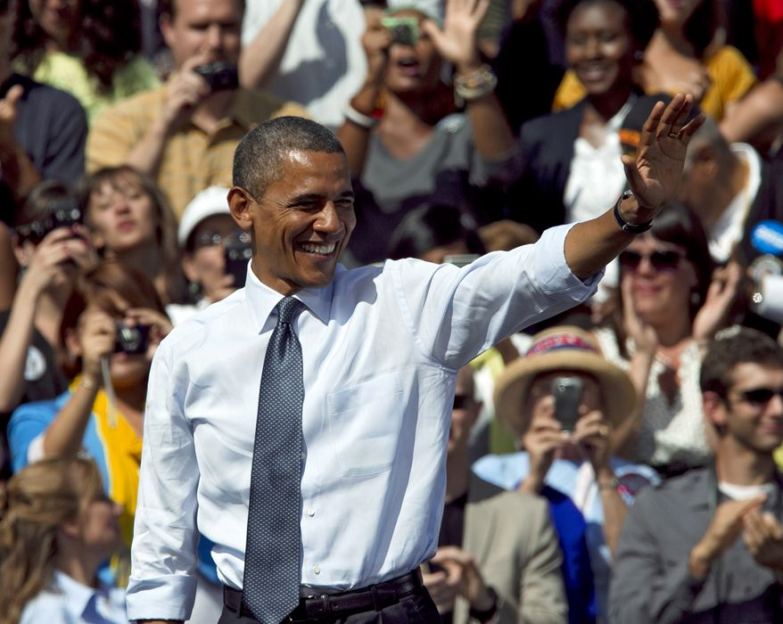 President Obama waves to the crowd after speaking at a campaign rally in Golden, Colo., on Thursday, Sept. 13, 2012. (AP Photo/Ed Andrieski)