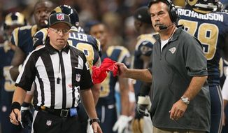 New Rams coach Jeff Fisher is eager to show that he's bringing a new brand of football to St. Louis. (St. Louis Post-Dispatch via Associated Press)