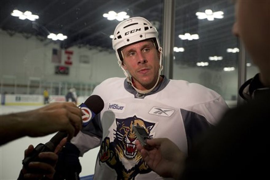Florida Panthers player Stephen Weiss talks to the media, Friday, Sept. 14, 2012 about the labor issues after an informal skate in Coral Springs, Fla. With a lockout drawing ever closer, the NHL and the players' union are in touch with each other after a day of internal meetings. But no new negotiating sessions are scheduled for Friday, one day before Commissioner Gary Bettman has said he will lock out the players. This would be the NHL's fourth work stoppage since 1992.(AP Photo/J Pat Carter)
