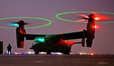 **FILE** A V-22 Osprey tilt-rotor aircraft taxies after a mission at Asad Air Base in western Iraq. (Associated Press)
