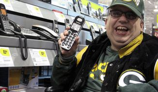 Sean Irvin looks for a telephone at a Best Buy on Monday, Sept. 17, 2012, in Anchorage, Alaska. A land-line phone is one of the things on which Mr. Irvin plans to spend his yearly Alaska Permanent Fund dividend. (AP Photo/Rachel D'Oro)
