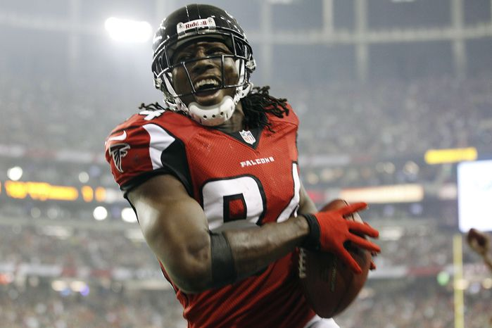 Atlanta Falcons wide receiver Roddy White (84) celebrates a touchdown against the Denver Broncos during the second half of an NFL football game, Monday, Sept. 17, 2012, in Atlanta. (AP Photo/David Goldman)