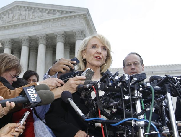 """**FILE** Arizona Gov. Jan Brewer speaks April 25, 2012, to reporters in front of the Supreme Court in Washington after the high court questioned Arizona's """"show me your papers"""" immigration law. (Associated Press)"""