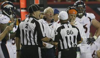 Denver Broncos head coach John Fox speaks to officials during the first half of an NFL football game against the Atlanta Falcons, Monday, Sept. 17, 2012, in Atlanta. (AP Photo/David Goldman)