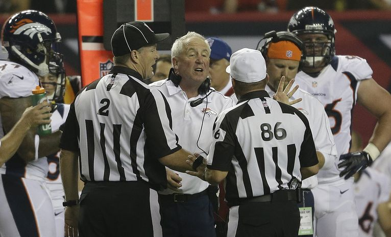 Denver Broncos head coach John Fox speaks to officials during the first half of an NFL football game against the Atlanta Falcons, Monday, Sept. 17, 2012, in Atlanta. (AP Photo/David Goldman)