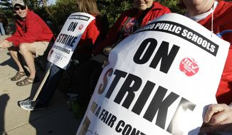 Teachers strike in 2012 because the mayor of Chicago asked for concessions. (AP Photo/M. Spencer Green)