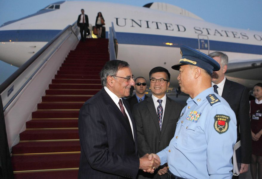 Defense Secretary Leon E. Panetta (left) shakes hands with Gen. Ma Xiao Tian, China's chief of the general staff,  as U.S. Ambassador to China Gary Locke (center) looks on after Mr. Panetta's arrival at Beijing Capital International Airport on Monday, Sept. 17, 2012. (AP Photo/Larry Downing, Pool)