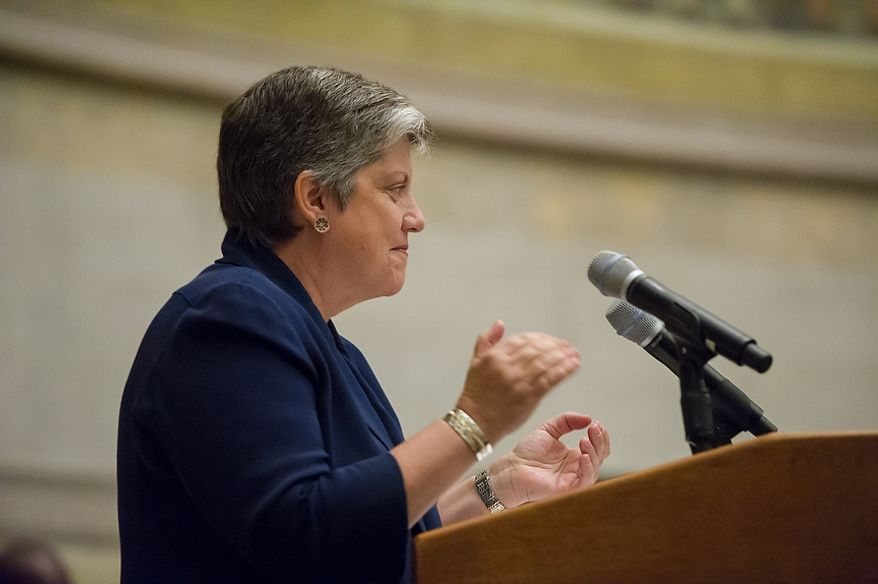 Secretary of Homeland Security Janet Napolitano applauds 225 newly sworn-in U.S. citizens on Sept. 17, 2012, at the National Archives Building in Washington. The ceremony commemorated the 225th anniversary of the signing of the U.S. Constitution. (Andrew Harnik/The Washington Times)