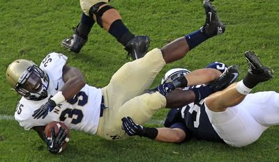 Navy fullback Prentice Christian (35) is tackled by Penn State linebacker Michael Yancich (33) during the fourth quarter of an NCAA college football game in State College, Pa., Saturday, Sept. 15, 2012. Penn State won 34-7.(AP Photo/Gene J. Puskar)