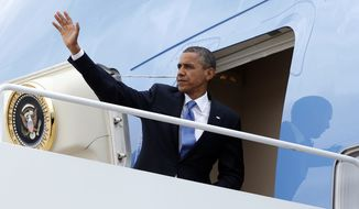President Obama boards Air Force One at Andrews Air Force Base, Md., en route to New York on Sept. 18, 2012. (Associated Press)
