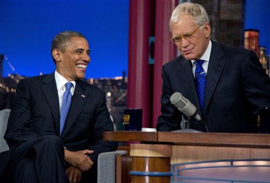 "President Obama talks with David Letterman on the set of the ""Late Show With David Letterman"" at the Ed Sullivan Theater, Tuesday, Sept. 18, 2012, in New York. (AP Photo/Carolyn Kaster)"